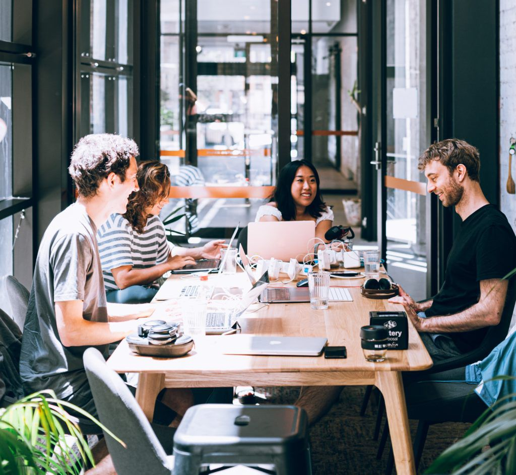 People sitting around a table, in a meeting