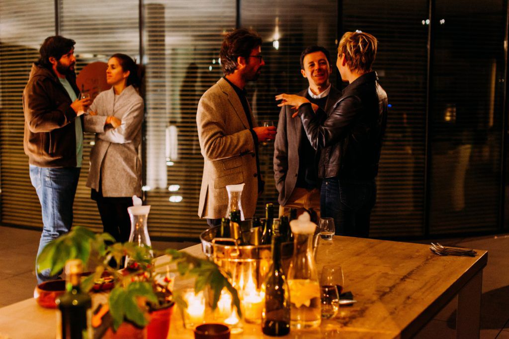 People at a cocktail party, conversating.