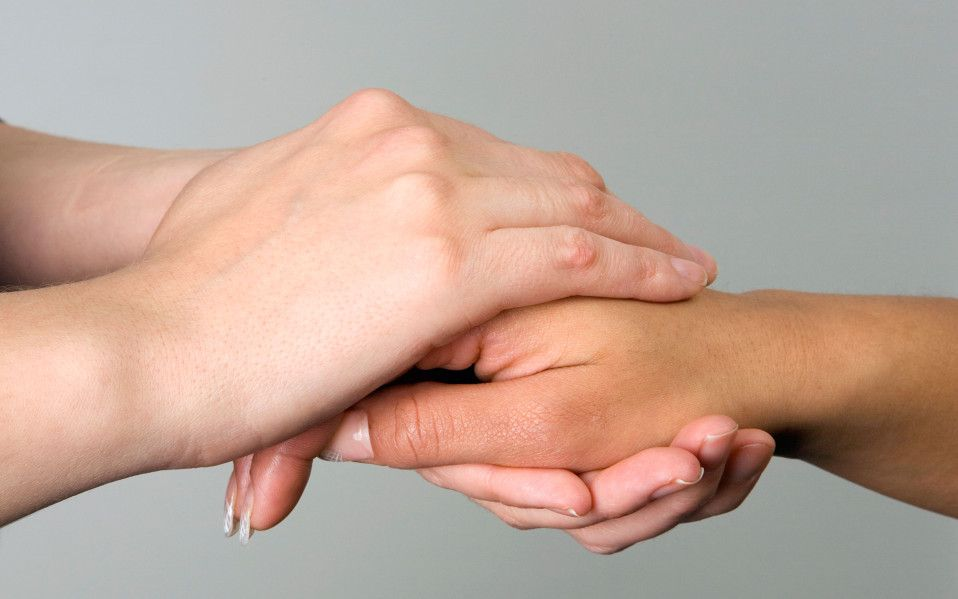 Mandatory Credit: Photo by Stock Connection/REX/Shutterstock (2385127a) 2 women holding hands and giving comfort to each other. VARIOUS