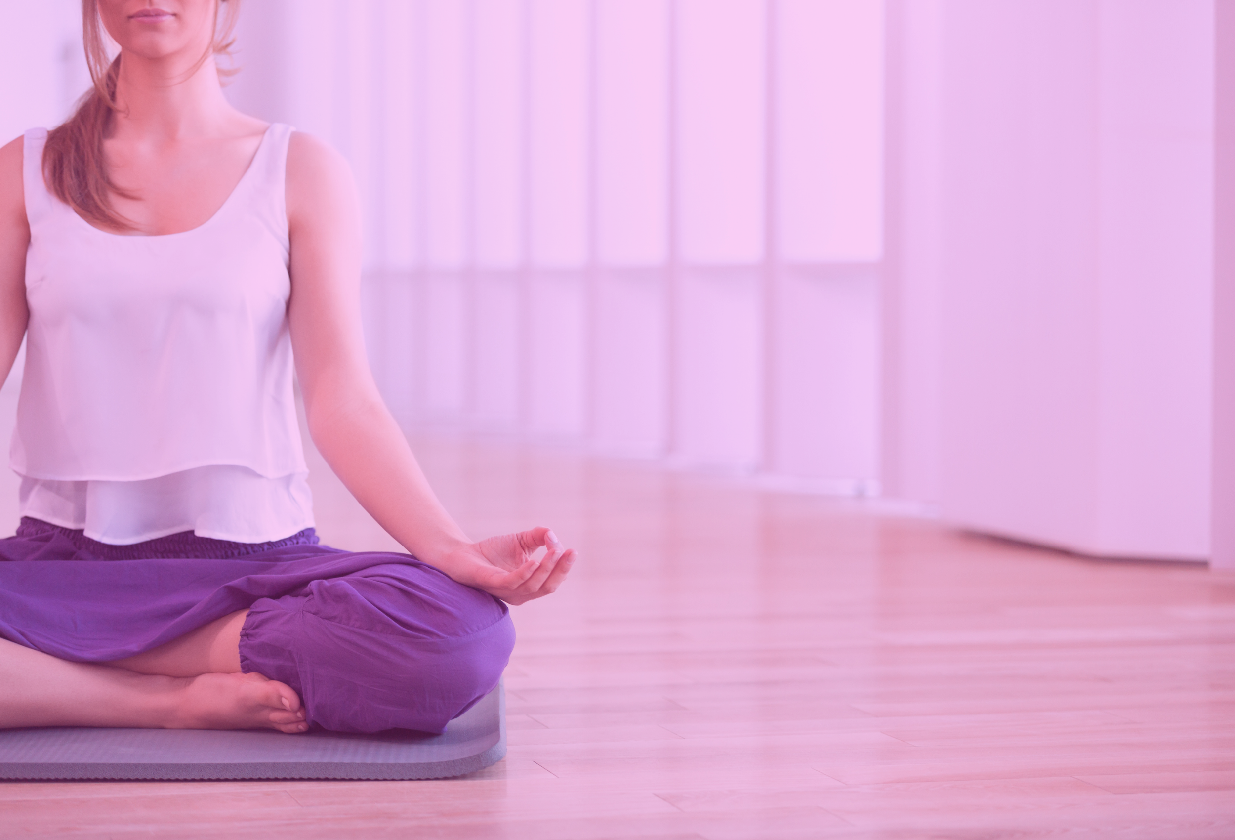 woman in yoga sitting pose in studio