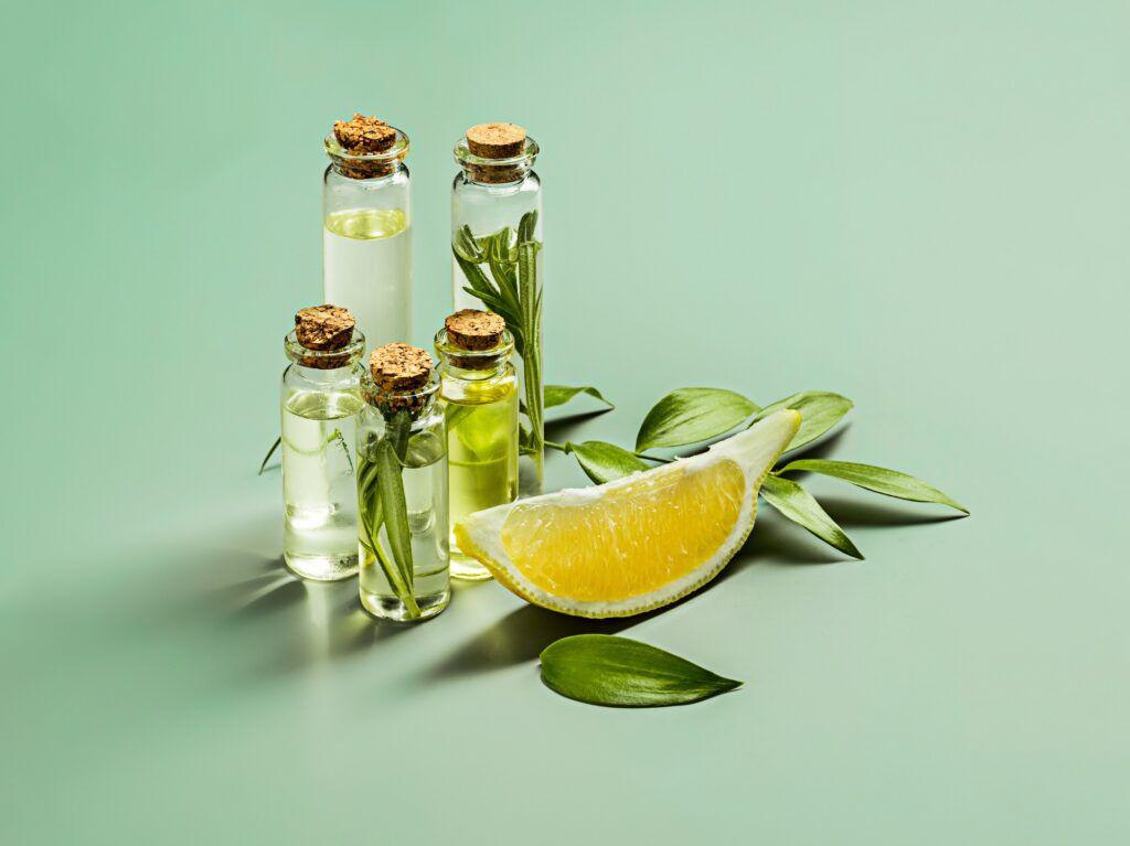 olive-oil-olive-branch-wooden-table