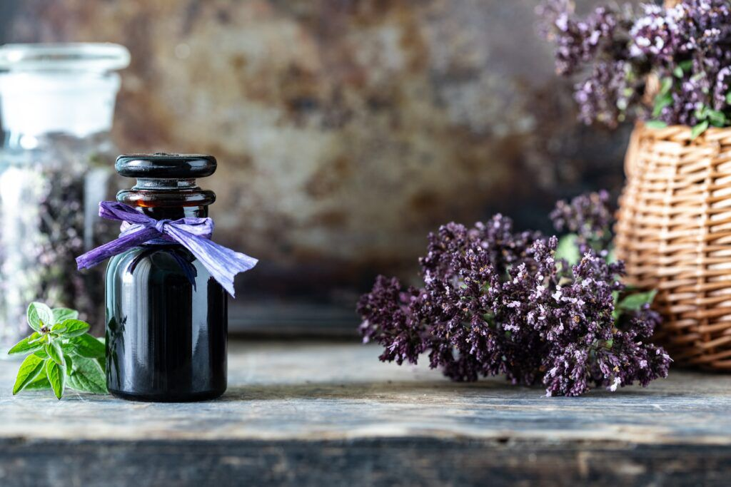 oregano-essential-oil-glass-bottle-wooden-background-copy-space
